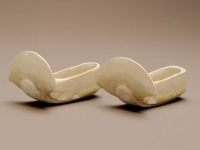 Miniature pair of slippers